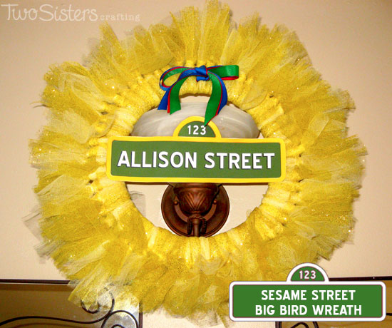 This Sesame Street Big Bird Tulle Wreath is so pretty and easy to make.  It will be a great decoration for your Sesame Street Birthday party.  Follow us for more fun Sesame Street Party Ideas.