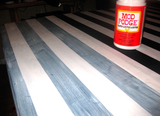 Mod Podge on the top of Fabric Covered Table