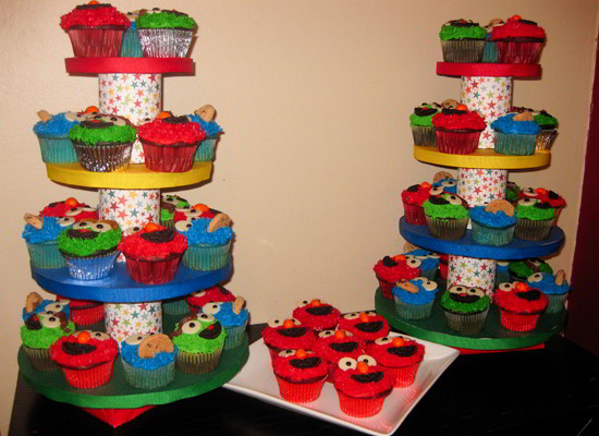 Our DIY Sesame Street Cupcake Stand was made with cardboard cake rounds, tin cans, ribbon and colored paper and was a great way to display our Sesame Street Cupcakes.  We have step by step directions on how to make one for your Seasame Street Birthday Party.  Follow us for more fun Sesame Street Party Ideas.