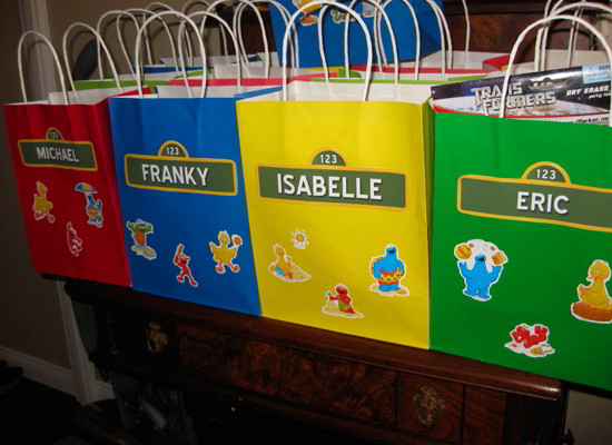 Sesame Street Party Bags with Personalized Name Tags - so easy to create and so fun for a Sesame Street Birthday Party. Follow us for more fun Sesame Street Party Ideas.