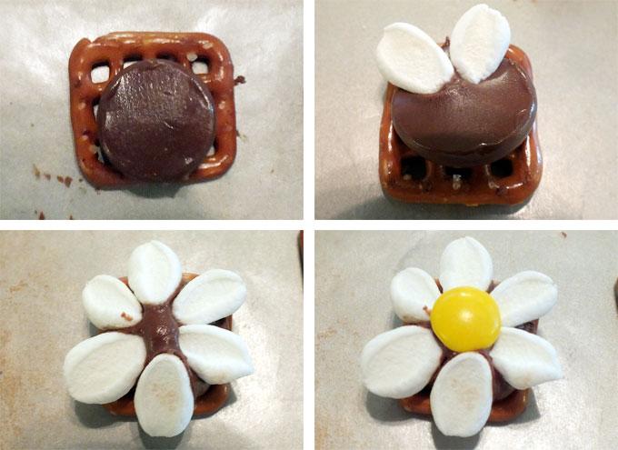 Adding marshmallow petals to the chocolate pretzel