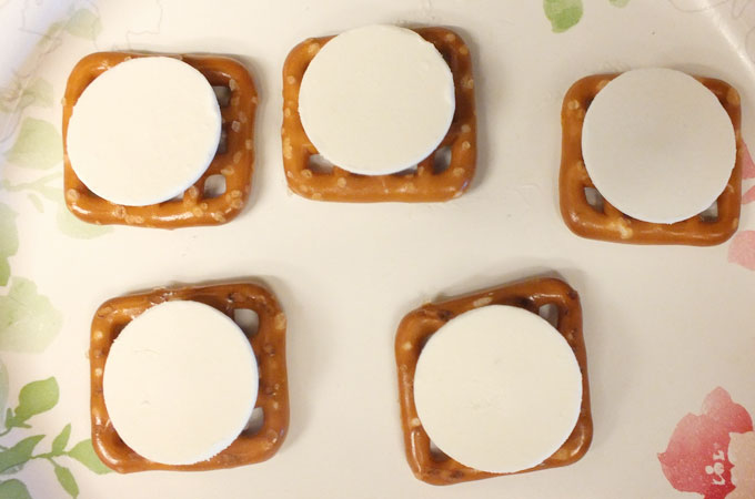 Wilton Bright White Candy Melts on the Pretzels