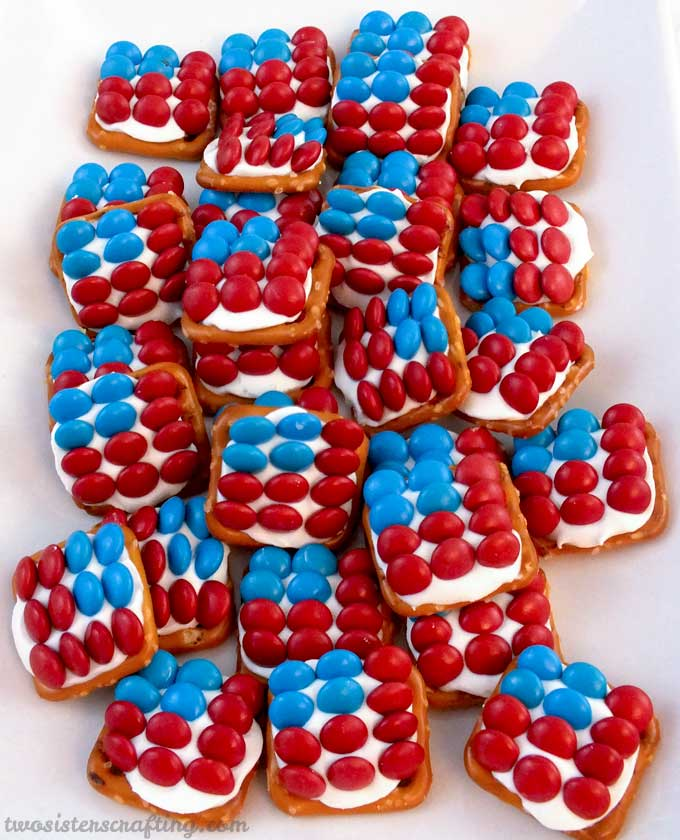 These fun Patriotic Pretzel Bites are the perfect Fourth of July dessert for a 4th of July Party, a Memorial Day BBQ or an Olympics viewing party. So easy to make and so sweet, salty and delicious. This yummy 4th of July treat is a true crowdpleaser.  Pin this 4th of July snack for later and follow us for more great 4th of July food ideas.