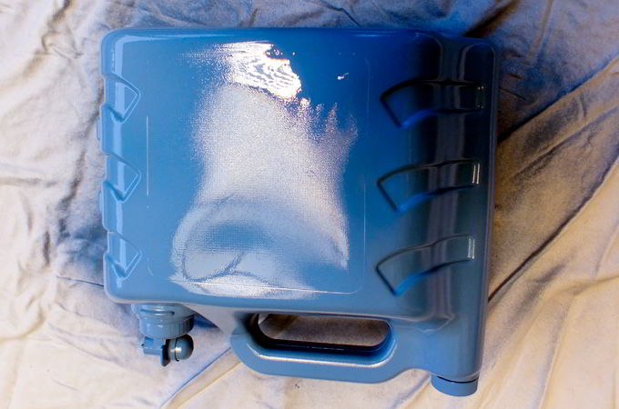 Spray paint the detergent container