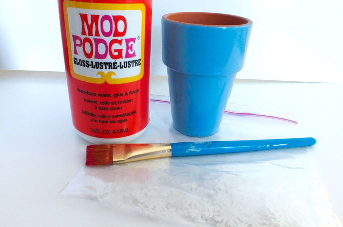 Using Mod Podge to add snowflake embellishments