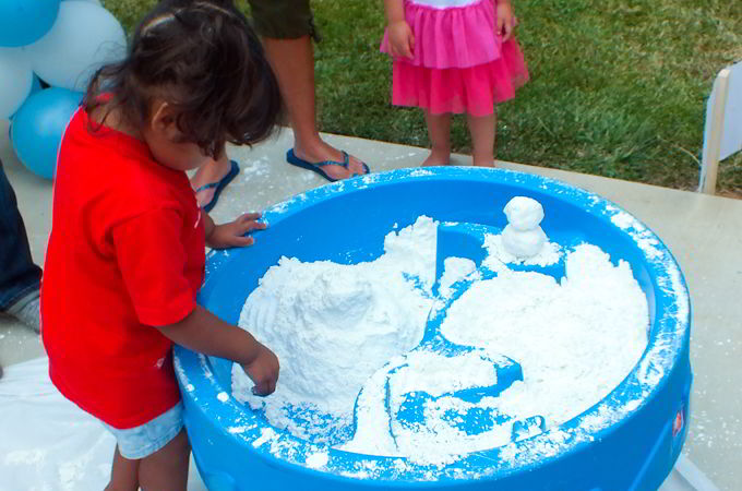Kids Playing at the Frozen Party Snow activity station