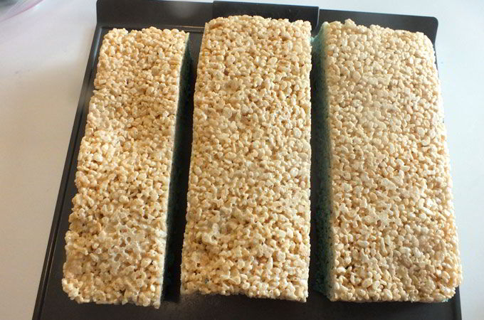 Cutting our Rice Krispie Treat layers into thirds