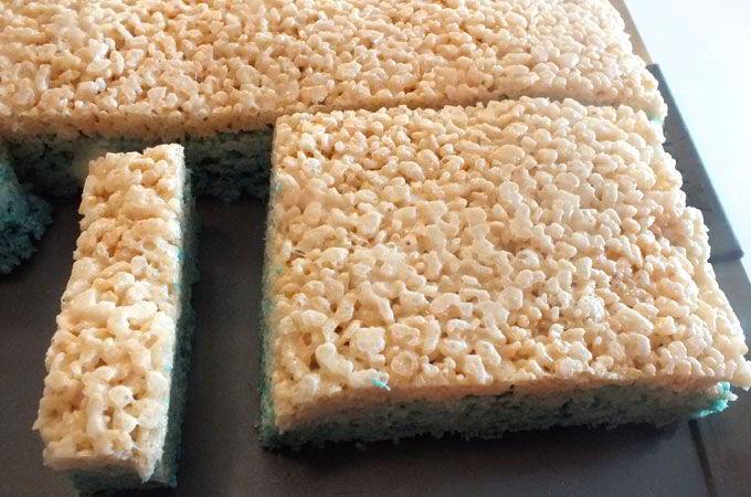 "Cutting a 1"" strip of Rice Krispie Treats"