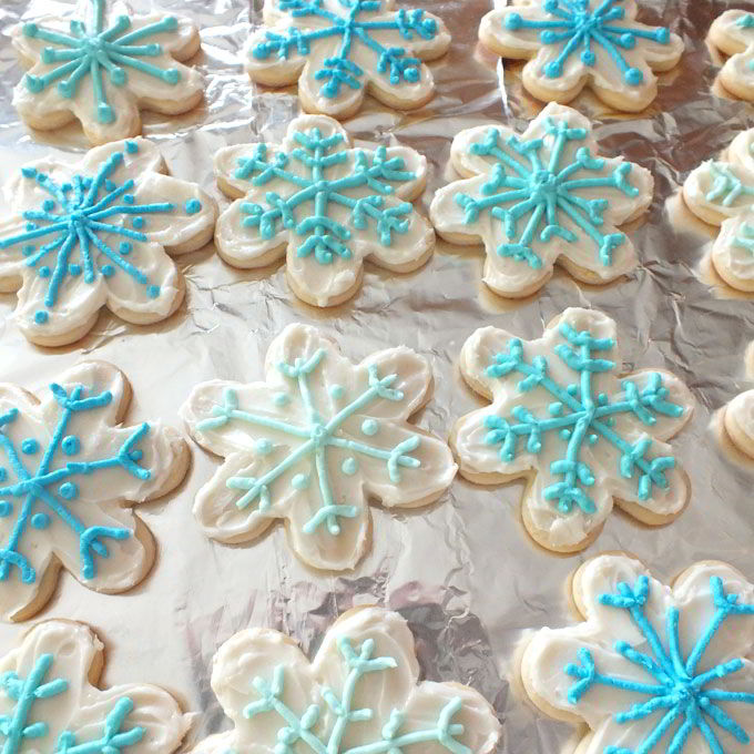 Frozen Snowflake Cookies decorated with ombre colored buttercream frosting