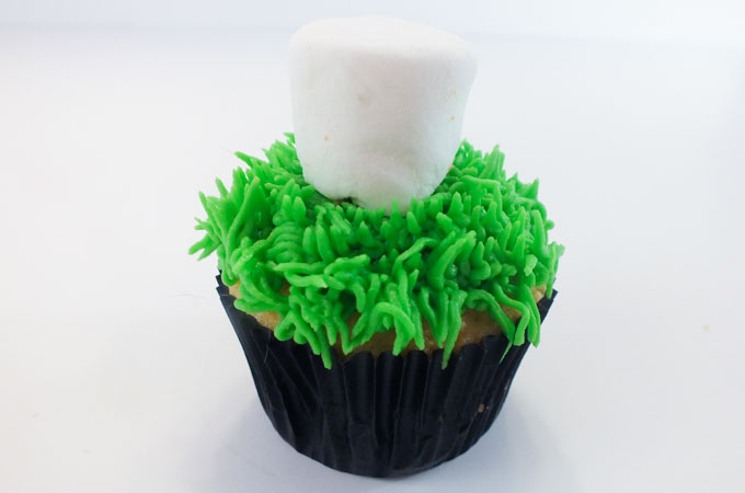 Place marshmallow on the cupcake