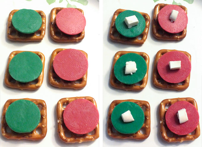 Positioning the candy melt on the pretzel snap