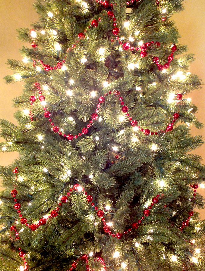 Santa christmas tree two sisters How to hang garland on a christmas tree