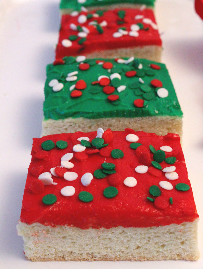 A unique take on a Frosted Sugar Cookie, these Christmas Sugar Cookie Bars are delicious, easy to make and will be an instant family favorite Christmas Dessert. Make your family a Christmas Treat that they are sure to love! Pin this yummy Christmas Cookie Recipe now and follow us for more more great Christmas Food ideas.