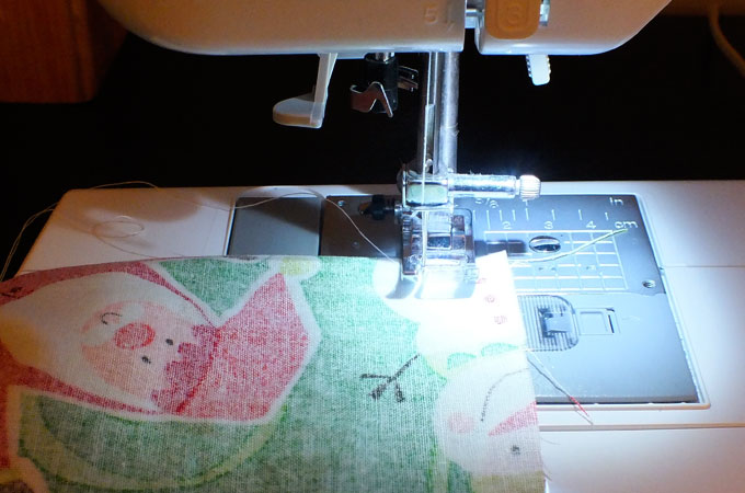Sewing the seams on the DIY Christmas Pillowcases