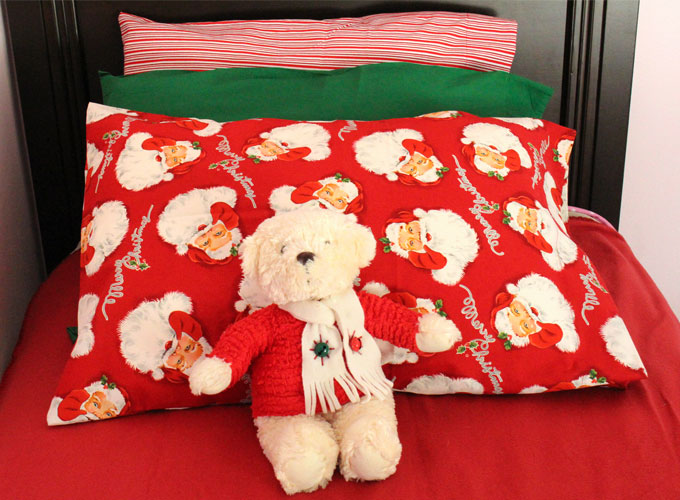 Christmas Pillow Cases - Here is a great Christmas idea - start a fun new Christmas tradition by making these Easy Handmade Pillow Cases.They will be so special not only because they are so adorable but also because they are only used during the holiday season! Follow us for more great Christmas Crafts.