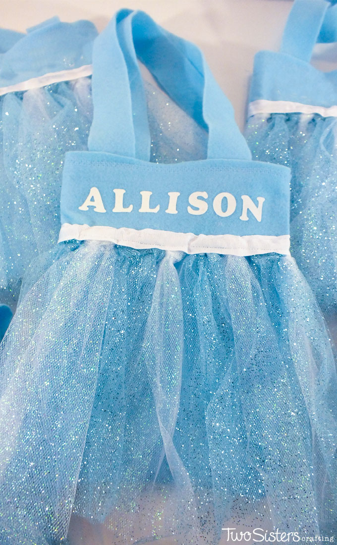 These Elsa Party Favor Bags are our favorite craft from our Frozen Birthday party. Fit for an ice queen and sparkly enough for a young girl they were the hit of the Frozen party.
