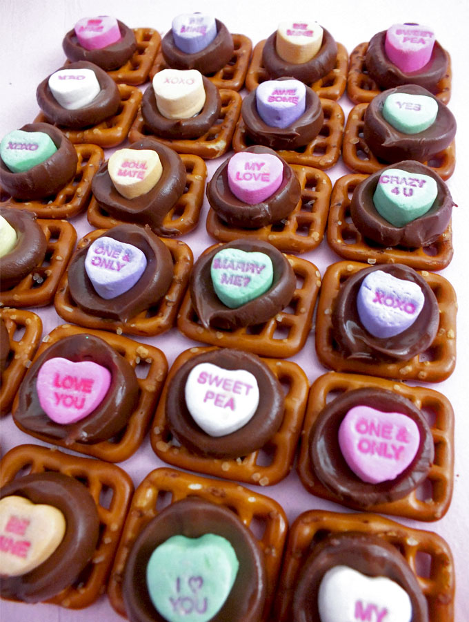 Conversation Hearts Pretzel Bites - we've taken an iconic Valentine's Day candy - Conversation Hearts - and turned them into a unique Valentines Day Treat. Sweet, salty and delicious, these are definitely a fun Valentines Day food idea. What a fun way to tell someone that you love them! Follow us for more great Valentines Day Dessert ideas.