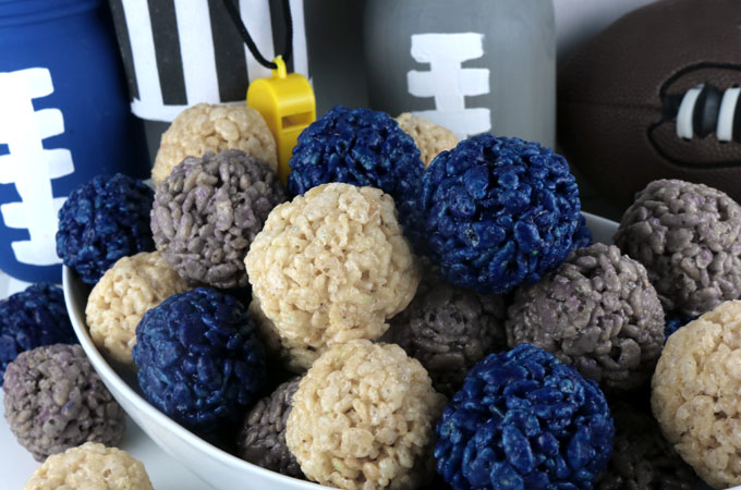 Dallas Cowboys Rice Krispie Bites -  Yummy, bite-sized balls of crunchy, marshmallow-y delight.  This is a Football dessert that is easy to make and even better to eat.  These colorful and festive Atlanta Falcon Treats are great for a game day football party, an NFL playoff party, a Super Bowl party or as a special snack for the Dallas Cowboys fans in your life. Go Cowboys!  Follow us for more fun Superbowl Food Ideas.