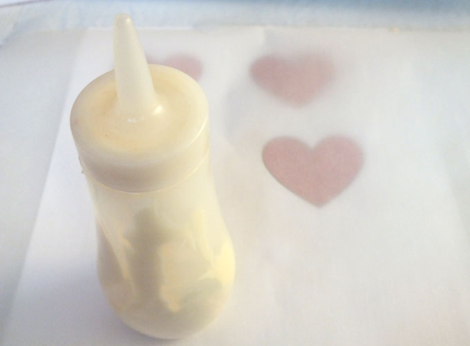 Melt White Chocolate and put it in a squeeze bottle