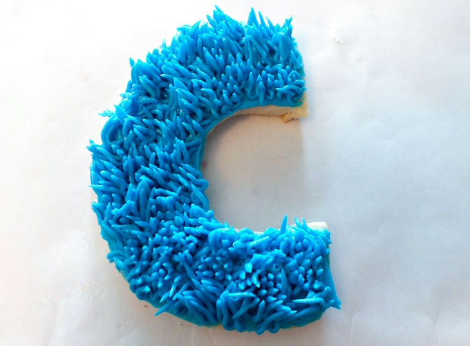 Add Cookie Monster fur using pastry bag