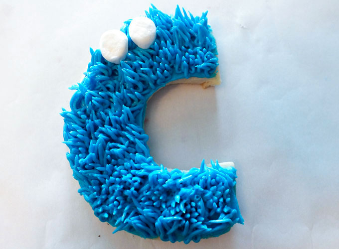 Add eyes to Cookie Monster Sugar Cookies