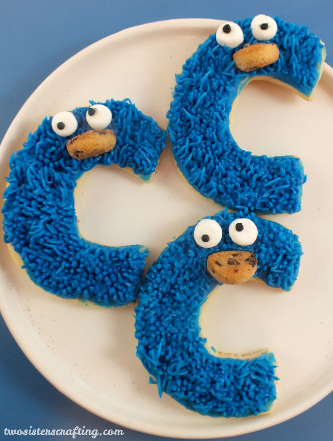 Cookie Monster Sugar Cookies for a Sesame Street Party or a Cookie Monster Birthday Party. So cute, so delicious and easier to make than you might think.   Follow us for more fun Sesame Street Party Ideas.