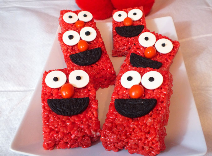 If you are looking for a fun dessert for your Elmo Birthday Party or Sesame Street Birthday Party these Elmo Rice Krispie Treats fit the bill. They are cute, yummy and so very easy to make!  We have step by step directions. Follow us for more fun Sesame Street Party Ideas.