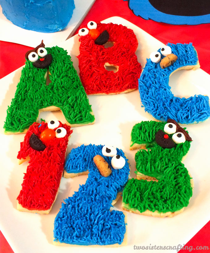 Everyone at your Sesame Street Party will love these adorable Sesame Street Frosted Sugar Cookies. So cute, so delicious and easier to make than you might think. Follow us for more fun Sesame Street Party Ideas.