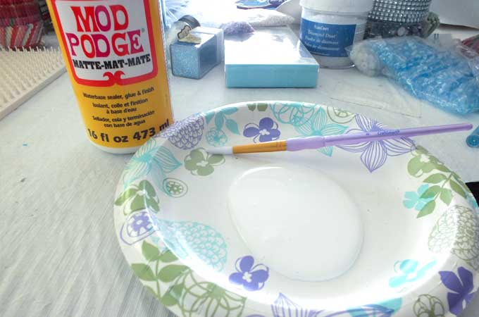 Use Mod Podge to attach glitter to the Embellished Easter Eggs