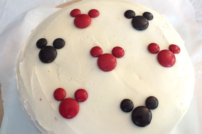 Covering the top of the Mickey Mouse Cake with M&M Mickey's
