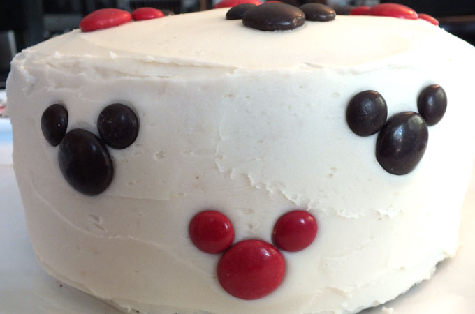 Adding M&M Mickey's to the side of the Mickey Mouse Cake