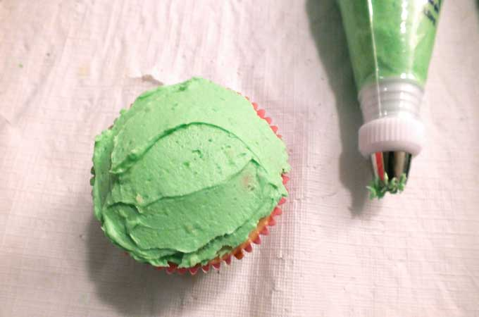 Add thin layer of frosting to Flower Cupcakes