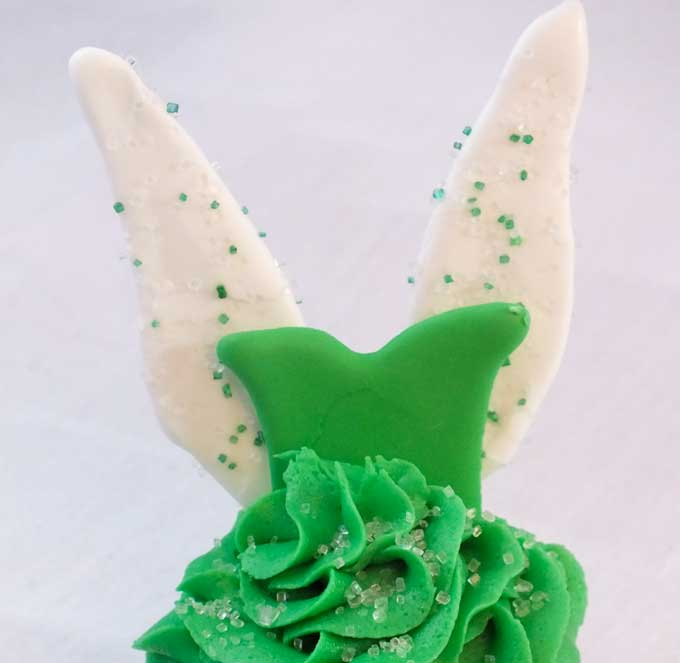 Tinkerbell Cupcakes - so cute and so delicious. Clap if you believe! We have all the directions to make these adorable Disney Tinker Bell Cupcakes that are perfect for a Tinkerbell Birthday Party. Follow us for more great Tinkerbell Party Ideas.