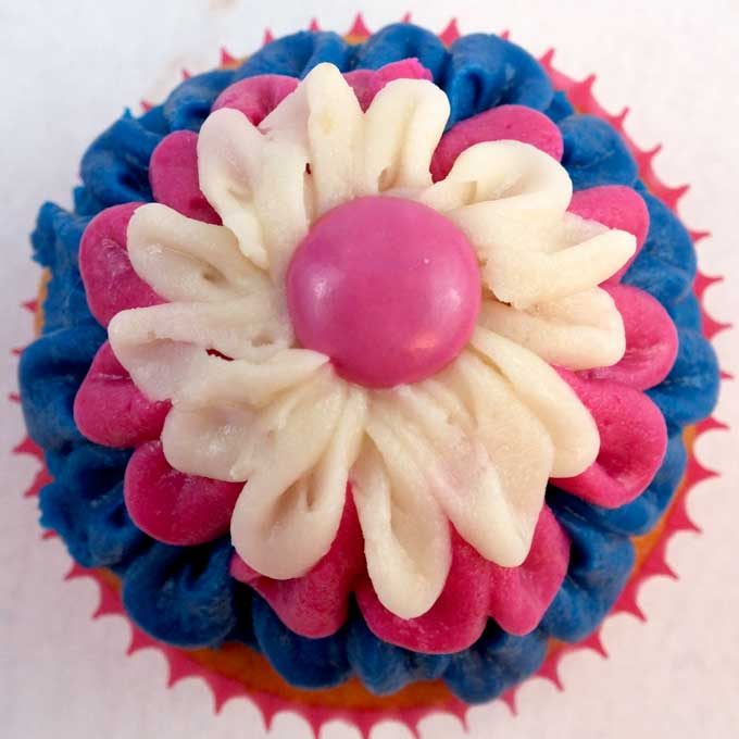 These Frozen Anna Cupcakes are adorable and delicious. It's so fun to create Frozen party food with these pretty blue and pink Anna colors! These yummy cupcakes will really stand out on a Frozen Party Dessert Table and we have all the directions you'll need to create them. Follow us for more great Frozen Party Ideas.