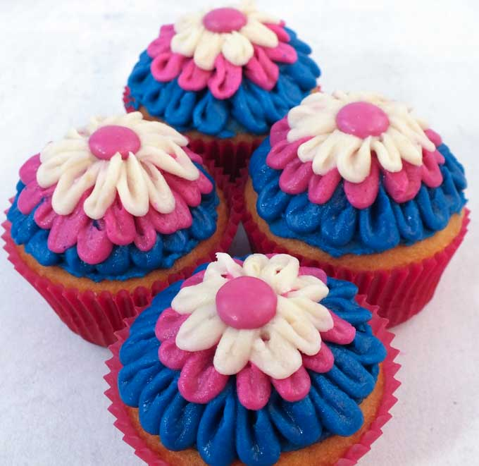 These Frozen Anna Cupcakes are adorable and delicious. It's so fun to create Frozen party food with these pretty blue and pink Anna colors! These yummy cupcakes will really stand out on a Frozen Party Dessert Table and we have all the directions you'll need to create them.