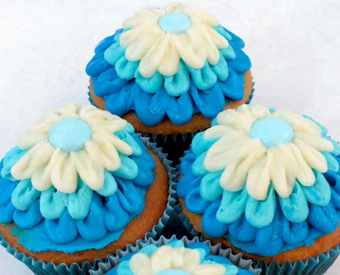 Everyone at your Frozen Birthday Party will love these Elsa Cupcakes. So pretty, so delicious and easier to make than you might think. These beautiful Frozen Cupcakes will look lovely on your Frozen Dessert Table and we have all the directions you'll need to create them. Follow us for more great Frozen Party Ideas.