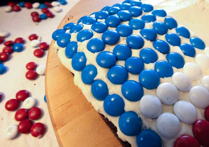 Start applying M&M's to the Flag Cake