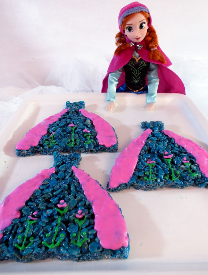 Anna's Dress Rice Krispie Treats are decorated to look like Princess Anna's iconic blue and pink dress and are great for a Frozen Birthday Party. They will be a hit at your Frozen Party and we have the step by step directions you'll need to make them for your own Frozen Party.