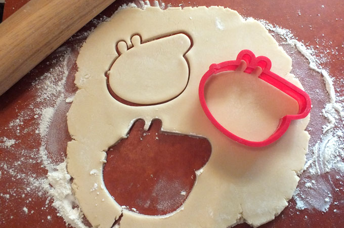 Cutting out the Peppa Pig Cookies