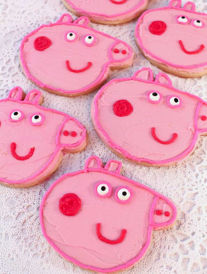 Peppa Pig Frosted Sugar Cookies for a Peppa Pig Birthday Party. So cute, so delicious and so easy to make. They will be a hit at your Peppa Pig party and we have all the directions you'll need to make them. Follow us for more fun Peppa Pig Party Ideas.
