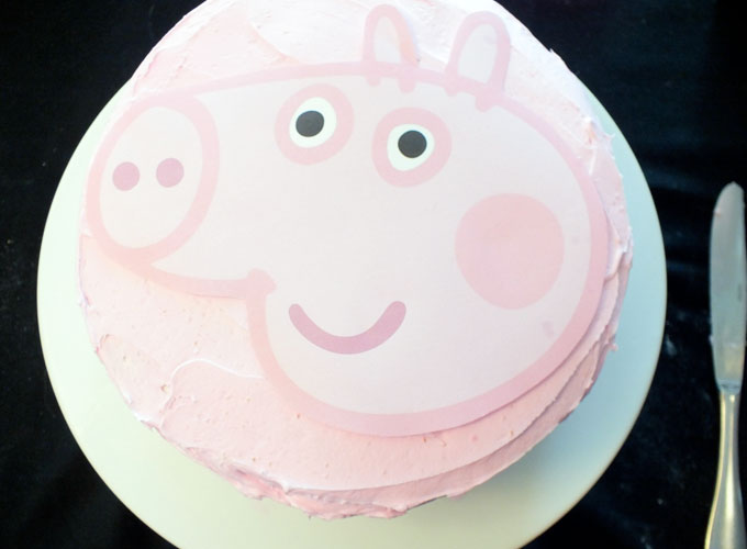 Trace the Peppa Pig Outline on the Frosted Cake