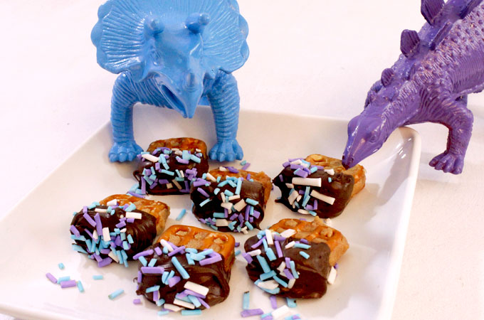 These Chocolate Peanut Butter Pretzel Bites are an easy to make and super delicious. We even made our own homemade sprinkles to match the theme of our Dinosaur Birthday Party! These yummy, sweet AND salty candy treats are great addition to any party's dessert table.  Follow us for more delicious Pretzel Bites ideas.