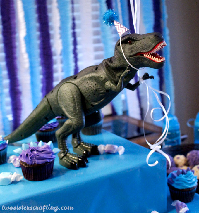 There were party hats for everyone at our Dinosaur Birthday Party including our ferocious Dinosaur friends! So adorable and so easy to make these DIY Dinosaur Party Hats are a great Dinosaur Party decoration idea. Follow us for more fun Dinosaur Party Ideas.