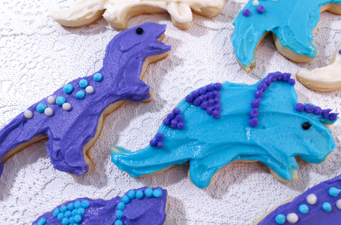 These Dinosaur Sugar Cookies are the perfect dessert for a Dinosaur Birthday Party. Kids will love these cookie versions of Tyrannosaurs and Triceratops. They are so easy to make and decorate and they taste delicious too. Follow us for more fun Dinosaur Party Ideas.