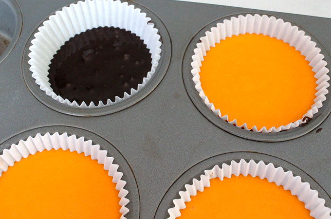 Fill remaining area of cupcake liner with orange cake batter