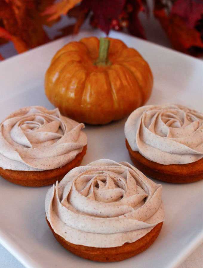 Pumpkin Mini Cakes with Cinnamon Buttercream Frosting are the perfect Fall Treat and a unique take on the classic cupcake. They would be a great Thanksgiving dessert for your guests who don't like pie. They would also look beautiful on your Christmas Dessert Table. Follow us for more great Thanksgiving Food and Christmas Food ideas.