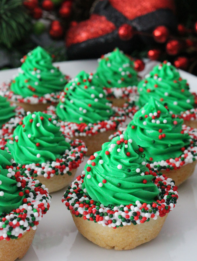 Christmas Tree Cookie Cups are fun, yummy and very easy to make. Try this special Christmas Treat and they will become instant family favorite Christmas Cookie. (They'd be a great for a Cookie Exchange too!) Follow us for more more great Christmas Dessert ideas.