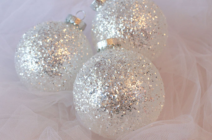 these diy white silver glitter christmas tree ornaments are a great christmas craft project