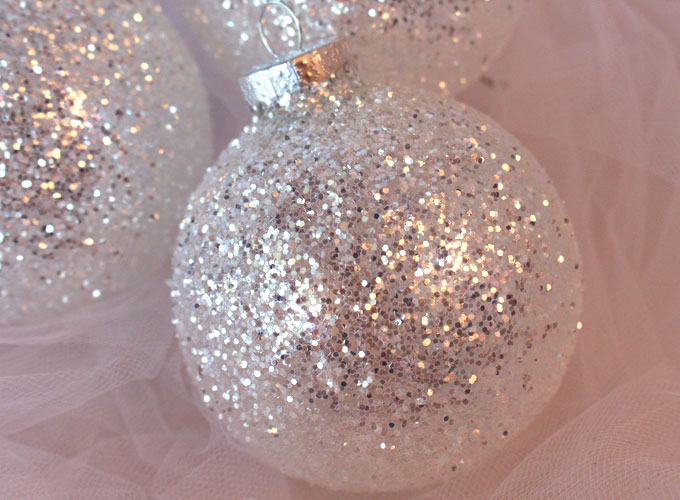 These DIY White & Silver Glitter Christmas Tree Ornaments are a great Christmas craft project. These handmade Christmas Ornaments are super easy to make and they will look amazing on your Christmas tree! Follow us for more great Christmas Decorations ideas and crafts.