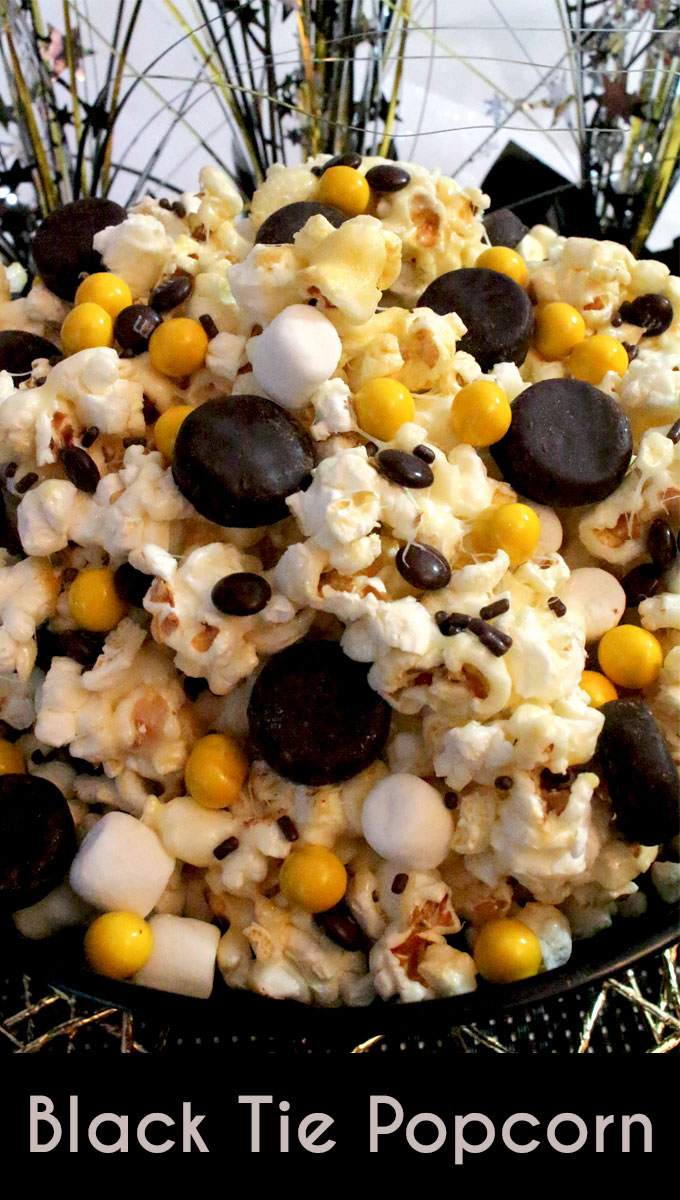 Celebrate New Years Eve with our Black Tie Popcorn - a fun Holiday Dessert that is both sweet and salty with an extra blast of minty chocolate. This yummy Party Food is super delicious and so easy to make. It would be a great Christmas Party Food or a movie night treat! Follow us for more fun New Years Eve Food Ideas.